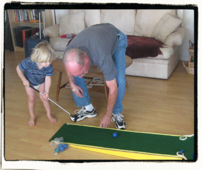 """Papa"" visits and brings miniature golf platforms."